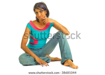 Beautiful brown woman sitting on the floor isolated over white