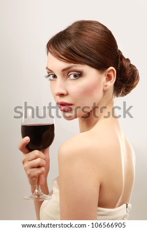 Beautiful brunet girl drinking red wine isolated - stock photo