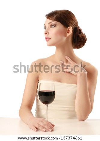 Beautiful brunet girl drinking red wine isolated on white background - stock photo