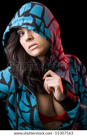 beautiful brunete girl in an aggressive attitude with a dark background - stock photo