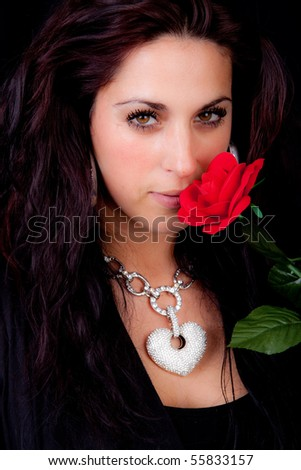 Beautiful brunette and a red rose - stock photo