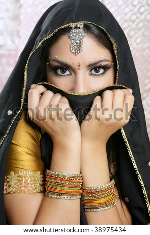 Beautiful brunette asian girl with black veil on face, traditional indian costume - stock photo