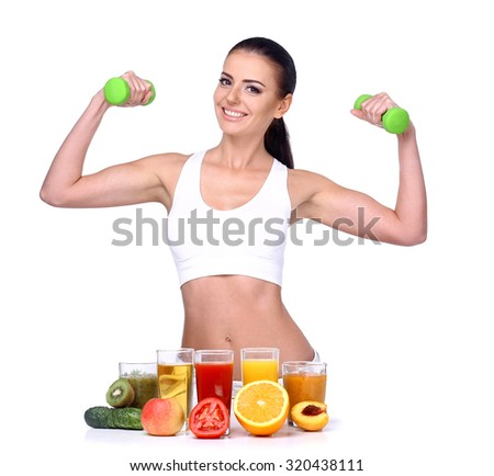Beautiful Brunette athlete holding dumbbells. It should be at the table with fruit and juice isolated on white background. - stock photo