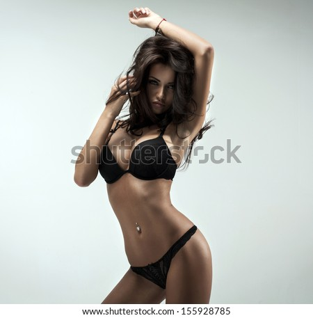 Beautiful brunette beauty in black underwear - stock photo