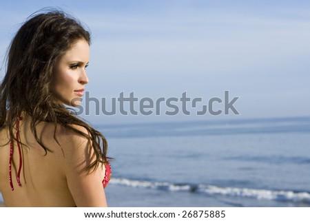 Beautiful brunette bikini model at the beach - stock photo