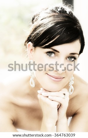 Beautiful brunette bride with hair tied back