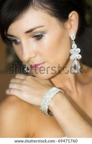 Beautiful brunette bride with hair tied back - stock photo