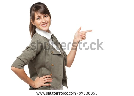Beautiful brunette business woman pointing at copy space over white background - stock photo