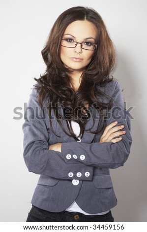 Beautiful brunette business woman with glasses - stock photo