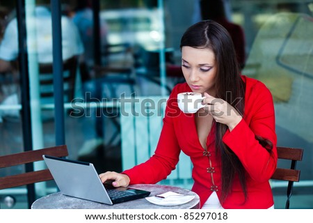 beautiful brunette businesswoman  in outdoors cafe - stock photo