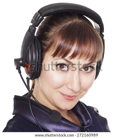 Beautiful brunette businesswoman operator with headset - stock photo