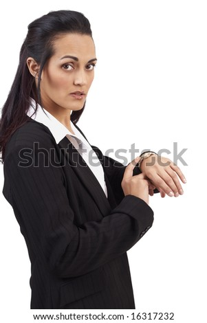 Beautiful brunette businesswoman wearing office clothes pointing to her watch - time is running out. Isolated on white background with copy space - stock photo