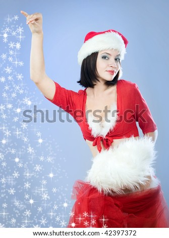 beautiful brunette christmas santa girl on blue background with snow