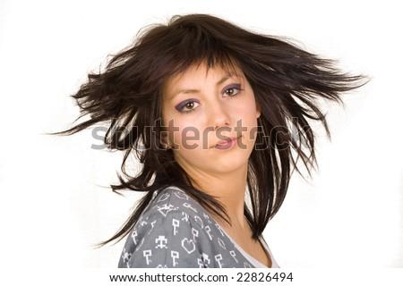 Beautiful brunette doing hair flip - stock photo