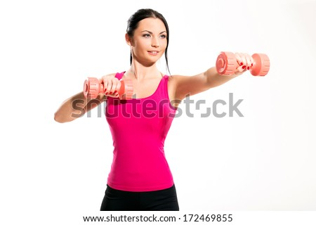 Beautiful brunette during fitness exercise with a dumbbell - stock photo