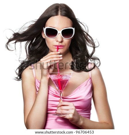 Beautiful brunette enjoying a cocktail - stock photo