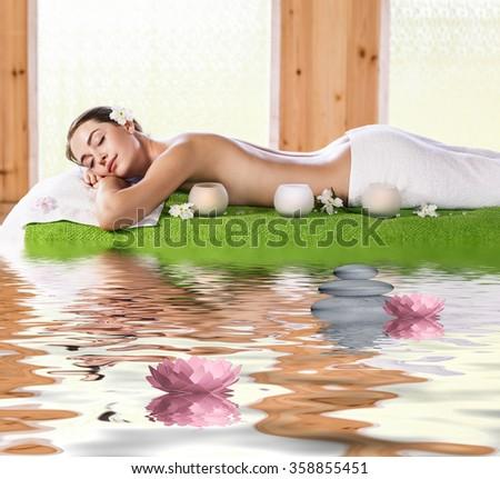 Beautiful brunette enjoying a massage  - stock photo