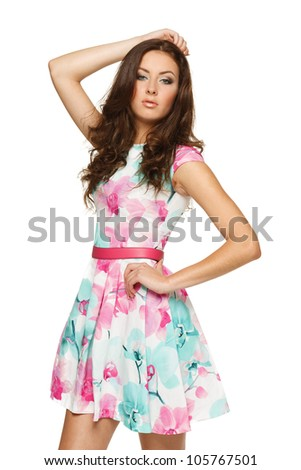 Beautiful brunette female in summer dress over white background - stock photo