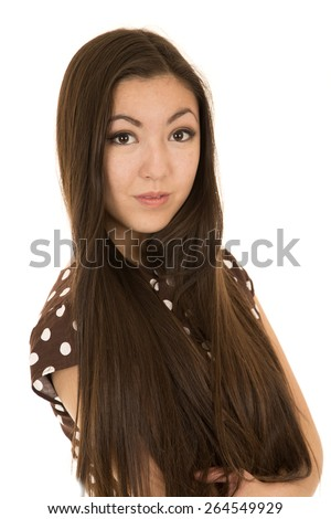 Beautiful brunette female model with arms folded - stock photo