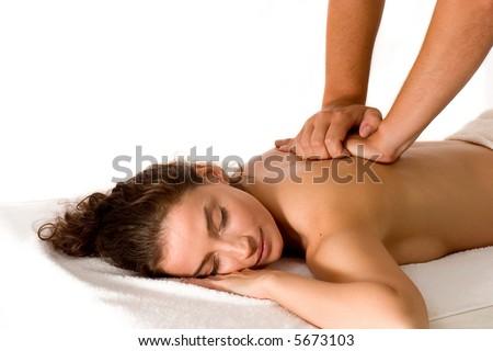beautiful brunette getting a massage - stock photo