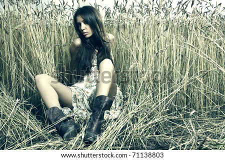 beautiful brunette girl at the field. Fashion photo - stock photo