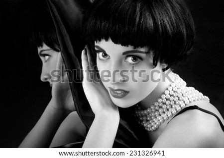 Beautiful brunette girl before a mirror  - stock photo