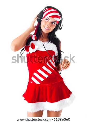 beautiful brunette girl dressed as santa listening to the music - stock photo