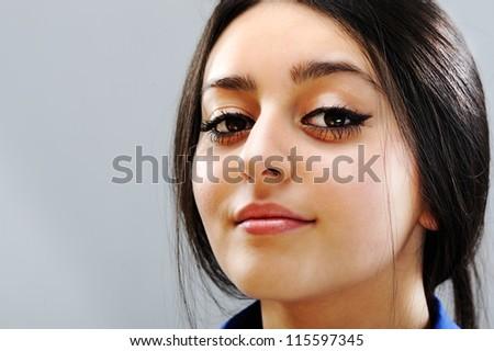 Beautiful brunette girl face - stock photo