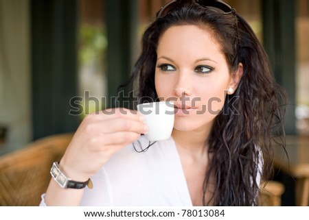 Beautiful brunette girl having a coffee. - stock photo