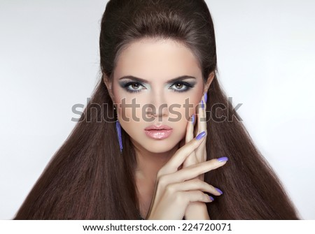 Beautiful Brunette Girl. Healthy Long Hair. Professional makeup. Manicured nails.  - stock photo