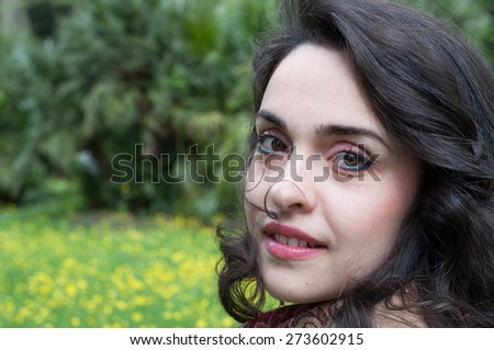 beautiful brunette girl in a sunny day at park