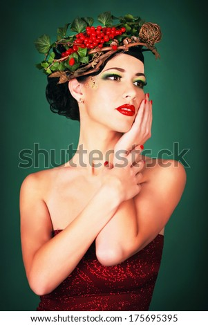 Beautiful brunette girl in a wreath
