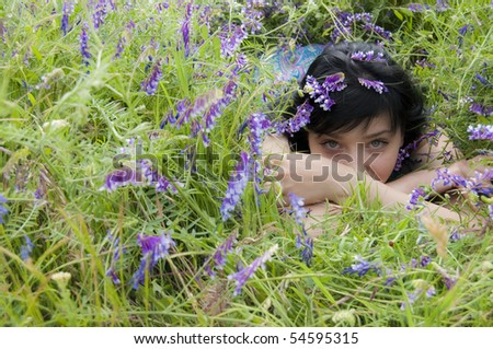 Beautiful Brunette Girl in Blue Flower - stock photo