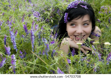 Beautiful Brunette Girl in Blue Flowers - stock photo