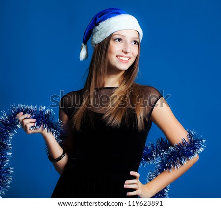 Beautiful brunette girl in christmas hat