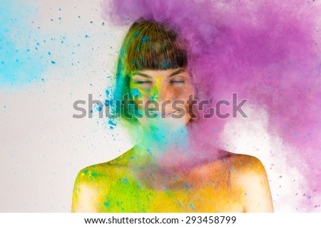 beautiful brunette girl in colors Holi on a white background