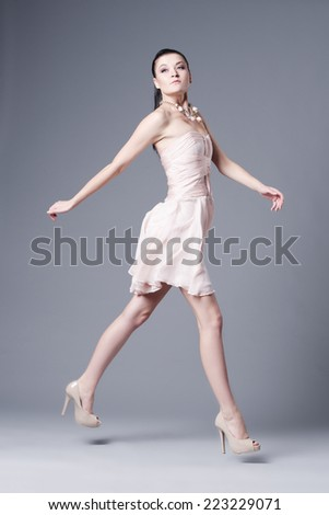 beautiful brunette girl in dress studio shot - stock photo