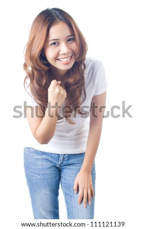 Beautiful brunette girl in jeans and white t-shirt smiling on white background