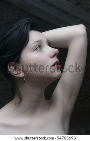 Beautiful Brunette Girl in low light - stock photo