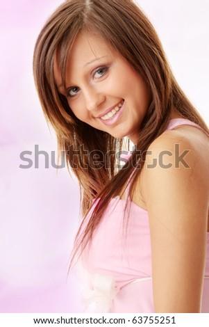 Beautiful brunette girl in sweet pink. - stock photo