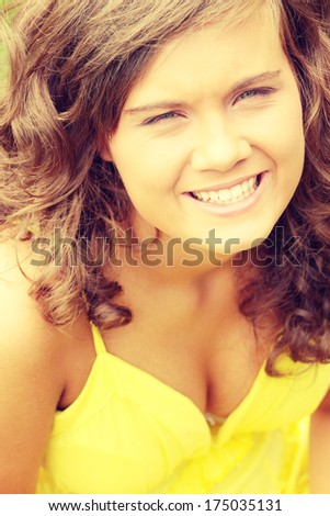 Beautiful brunette girl in yellow summer dress. Isolated on white background