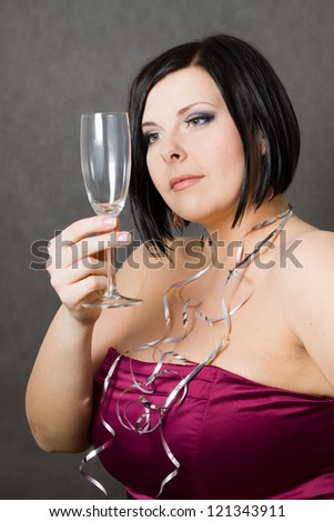 Beautiful brunette girl looking at empty glasses