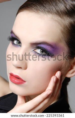 Beautiful Brunette Girl. Luxury Makeup-gray background - stock photo