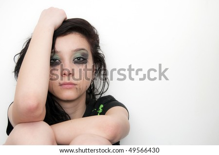 Beautiful Brunette Girl Portrait crying, over make up - stock photo