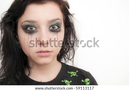 Beautiful Brunette Girl scared, over makeup - stock photo