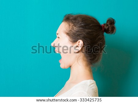 beautiful brunette girl shouting - stock photo