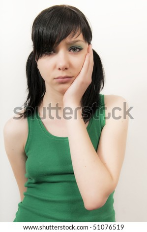 Beautiful Brunette Girl wit Tooth Ache - stock photo