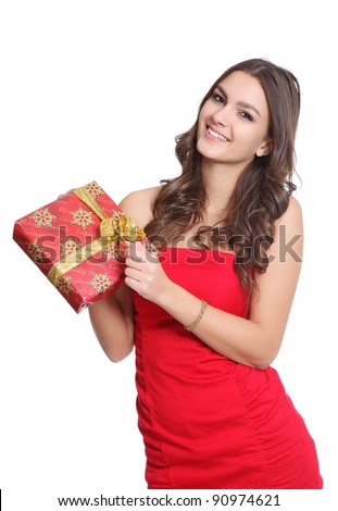 Beautiful brunette girl with a gift - stock photo