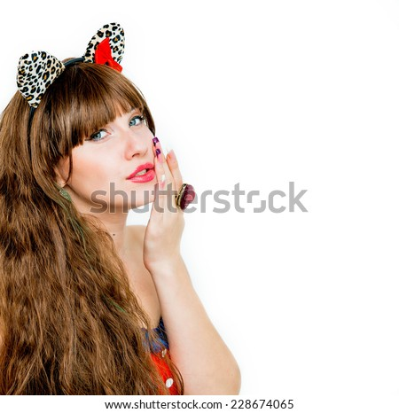 Beautiful brunette girl with a heart ring white background