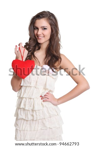 Beautiful brunette girl with a heart sign in her hand - stock photo